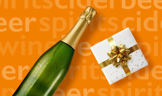 Bottle of sparkling wine and present -Henrys functions and events